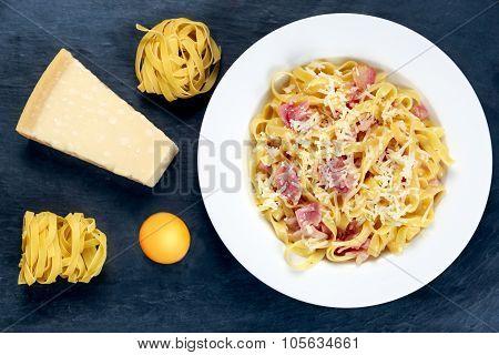 Classic Pasta carbonara Italian. decorated with tangliatelle spa