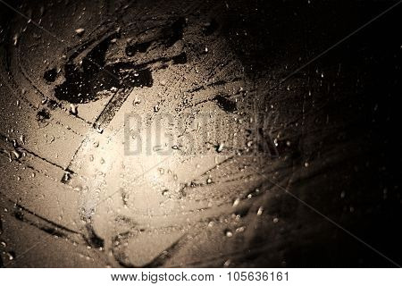 Abstract Light Effects On A Wet Glass Pane With Water Drops