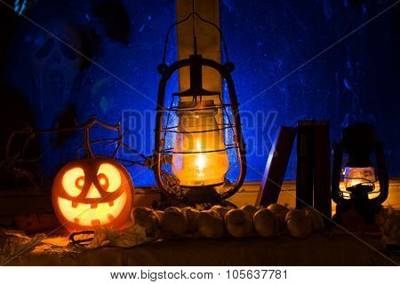 Photo Composition For Halloween From Mad Pumpkin, An Oil Lamp And Old Books