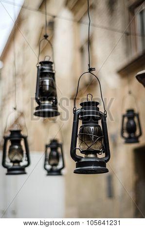 Antique kerosene lamps hanging on street