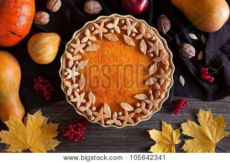 Homemade pumpkin tart pie organic sweet dessert food with various decoration on top. Traditional hal