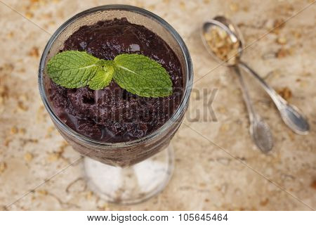 Acai Pulp In Glass With Fresh Mint And Muesli