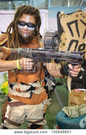 MOSCOW - OCT 12, 2014: Cosplayer with dreadlocks and wearing glasses with a gun in his hand at the EveryCon 2014 in the exhibition center Sokolniki