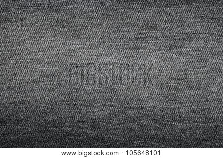 Closeup background photo of texture of Dark grey denim jeans textile