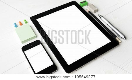 Tablet And Cellphone With Office Supplies