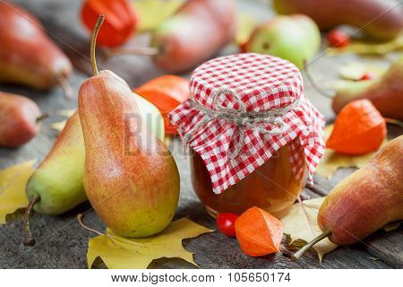 Pear Jam And Ripe Pears On Old Wooden Table. Autumn Still Life. Selective Focus.