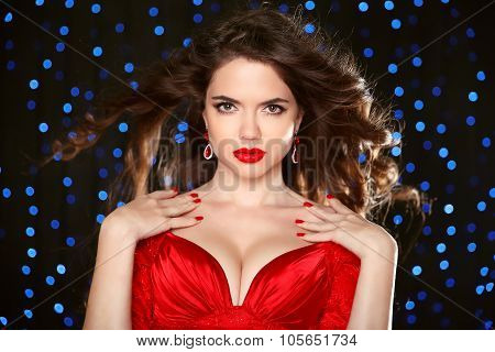 Attractive Girl With Makeup. Red Lips. Jewelry Earring. Manicured Nails. Expressive Eyes Stare. Eleg