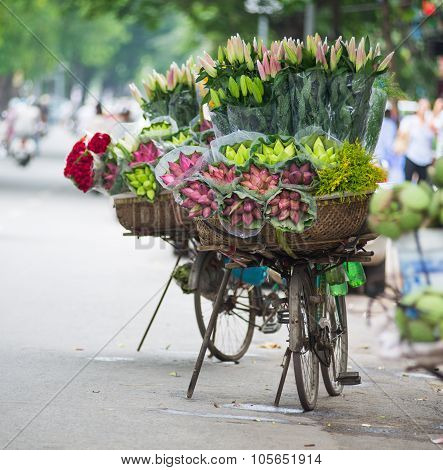 Lotus flower on bicycle of street vendor in Hanoi, Vietnam