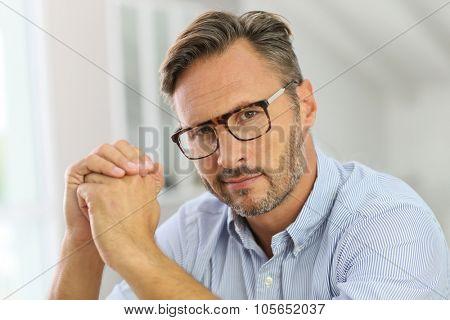 Portrait of handsome mature man with eyeglasses