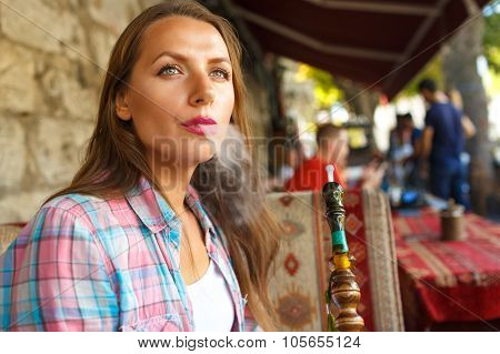 Woman Smoking A Shisha And Relaxing In The Cafe, Istanbul, Turkey