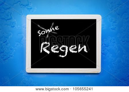 Blackboard With German Words'sonne-regen'(sun-rain)