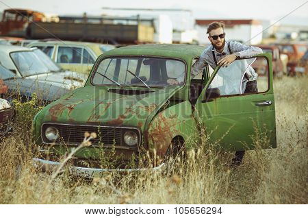 Young Stylish Handsome Man, Wearing Shirt And Sunglasses, Driving Old Car
