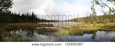 Panoramic View Of Myrflodammen Near Saelen, Sweden. A Shot On A Rainy And Sunny Day Were Made From T