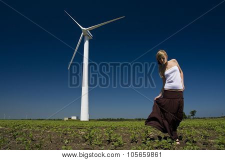 Female At Wind Power Generator