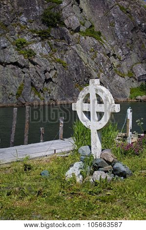 Celtic cross along the shore in Quidi Vidi which is part of St. John's, Newfoundland, Canada.