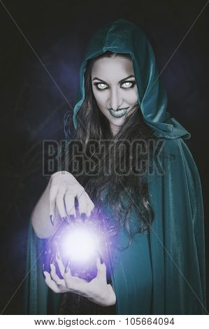Halloween Witch With Fireball In Her Hands