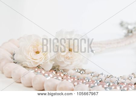 Close Up Of Beaded Necklace With Flowers
