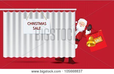 Santa Claus with big sale paper bag behind curtain