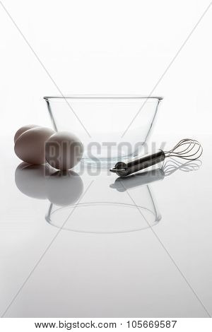 Glass bowl whisker eggs side view with reflection vertical