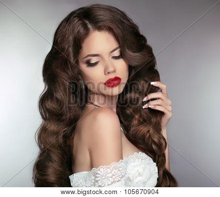 Wavy Hair. Beautiful Brunette Girl. Makeup. Red Lips. Healthy Long Hair. Beauty Model Woman. Curly H