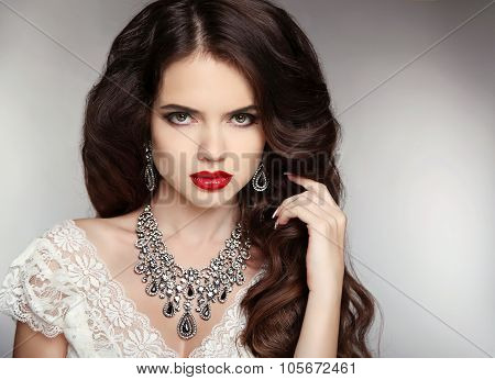 Hairstyle. Makeup. Jewelry. Beautiful Woman With Curly Hair And Evening Make-up. Beauty Fashion Girl