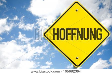 Hope (in German) sign with sky background