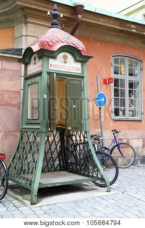 STOCKHOLM, SWEDEN - May 19, 2015: Old Rikstelefon telephone booth in Gamla Stan district in Stockholm