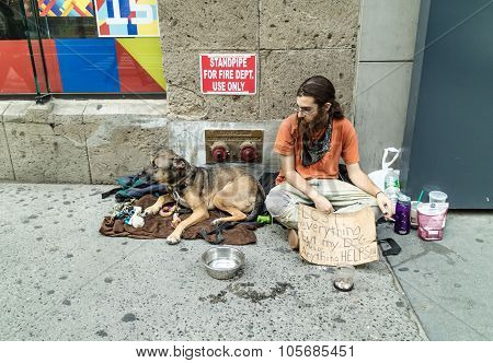 Homeless With His Dog In New York Street