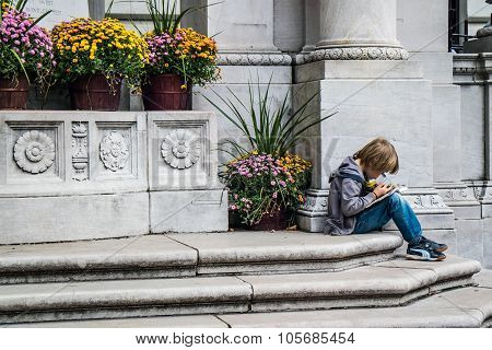 Boy Studing In Bryant Park New York