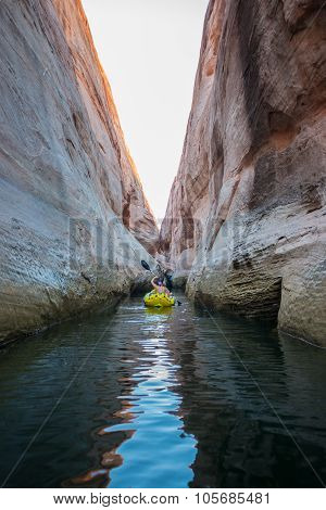 Kayaker Paddling The Calm Waters Of Lake Powell Utah