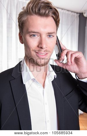 Portrait Young Business Man In Suit On The Phone
