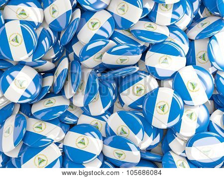 Background With Round Pins With Flag Of Nicaragua
