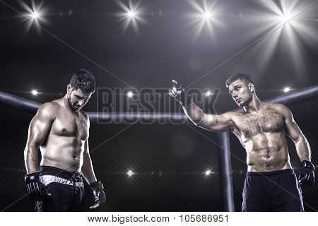 MMA fighters in octagon arena before fight