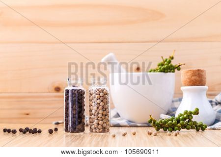 Assorted Of Spice Bottles Condiment Black Pepper ,white Pepper And  Green Pepper Seeds With Mortar O