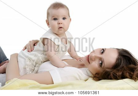 Studio shot of happy mother and her adorable child