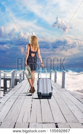 Young woman walking on wooden pier.