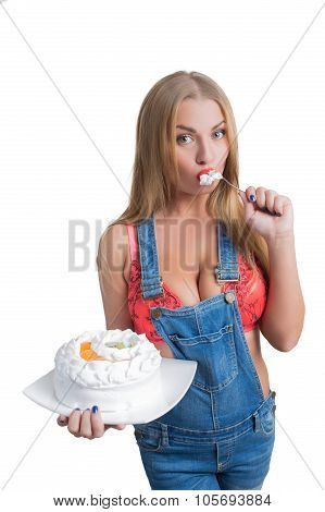 Busty sexy girl eating cake with whipped cream
