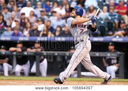 DENVER-AUG 21: New York Mets catcher Travis d'Arnaud swings at a pitch during a game against the Colorado Rockies at Coors Field on August 21, 2015 in Denver, Colorado.