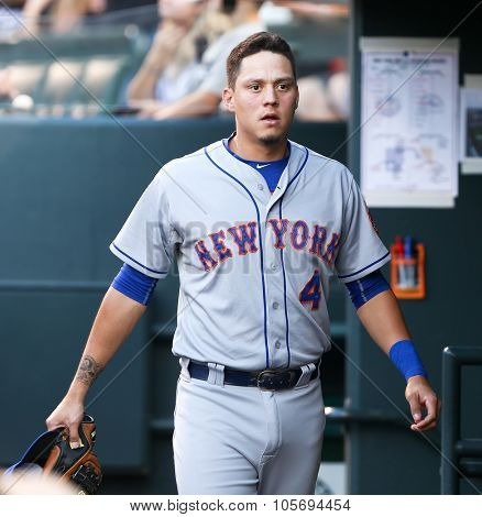 DENVER-AUG 21: New York Mets infielder Wilmer Flores waits for a pitch during a game against the Colorado Rockies at Coors Field on August 21, 2015 in Denver, Colorado.