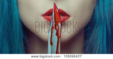 Woman Kissing A Knife In Blood