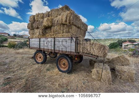 Vintage tractor trailer fully loaded with bales of hay