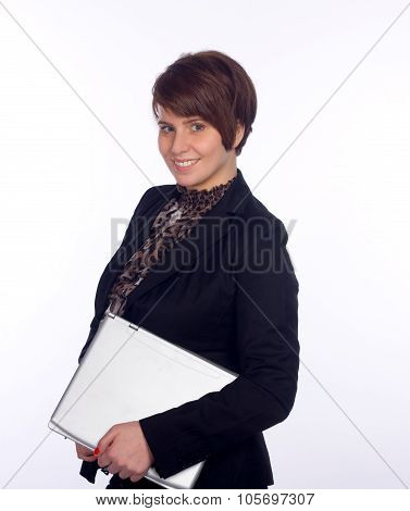 Smiling businesswoman holding laptop under one's arm