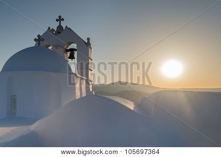 Beautiful church Saint Antony in Paros island in Greece against the sunset.