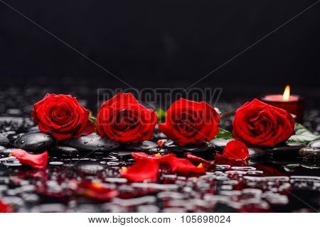 Still life with red rose with candle and therapy stones