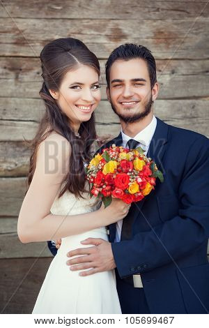 Just Married Couple Happy Smiling On Wodden Background