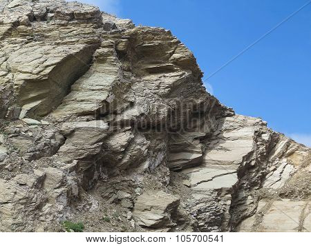 Laminated Structure Of Mountain Rock Over Blue Sky
