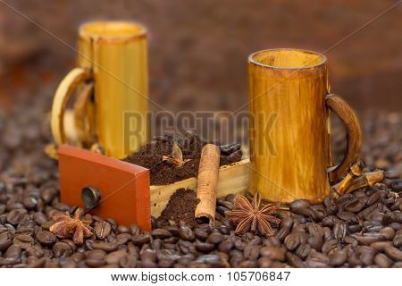 bamboo cups and coffee beans cofee grinded in wood box anis and cinnamon