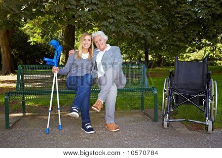 Handicapped Women On A Park Bench