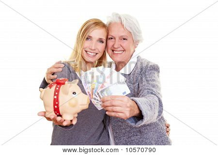 Grandmother And Grandchild Holding Piggy Bank