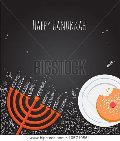 Hanukkah menorah and doughnut over chalkboard